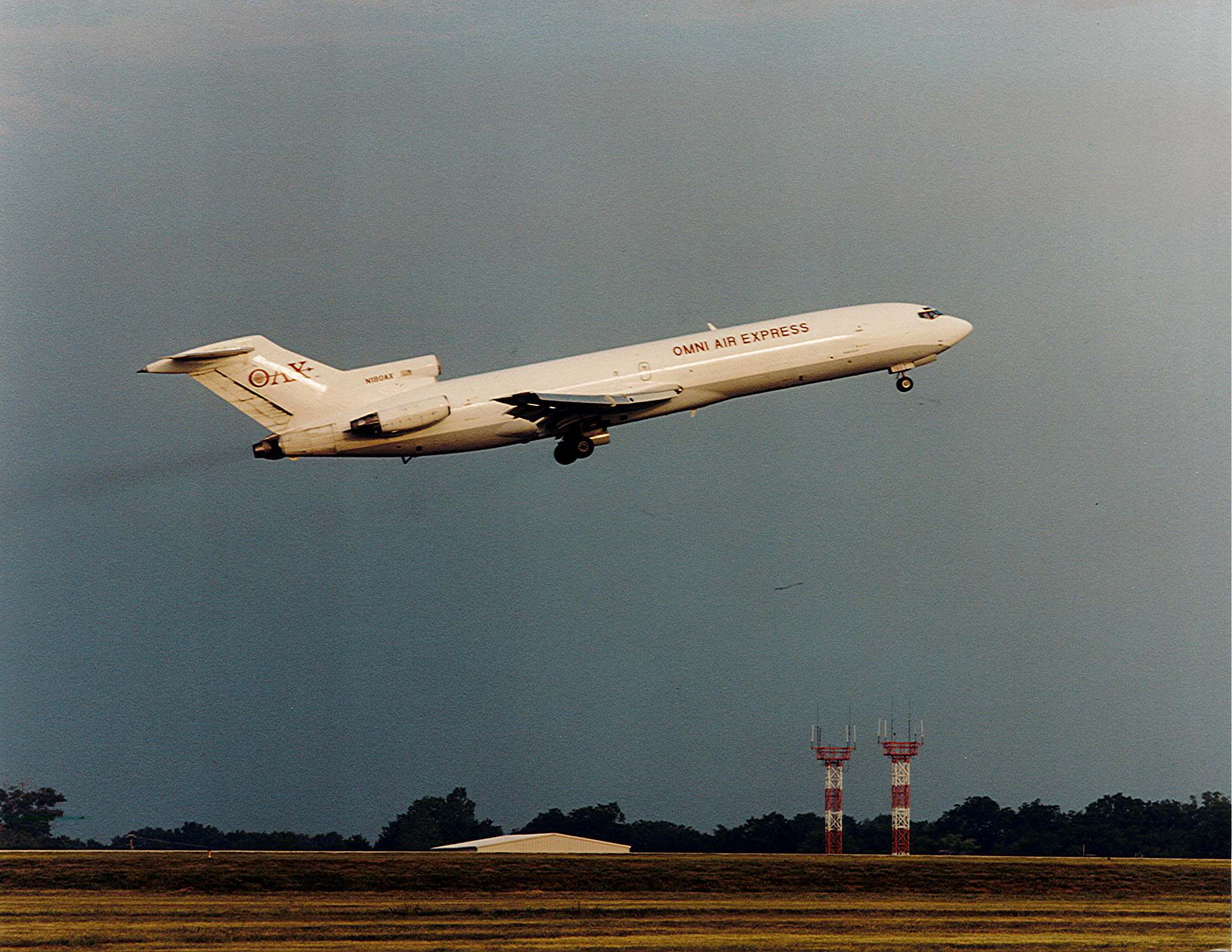 An Omni widebody charter Boeing 727 takes off