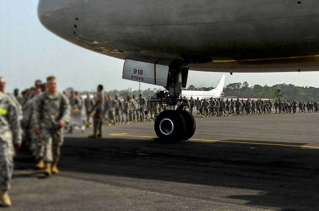 Soldiers disembark from government charter aircraft